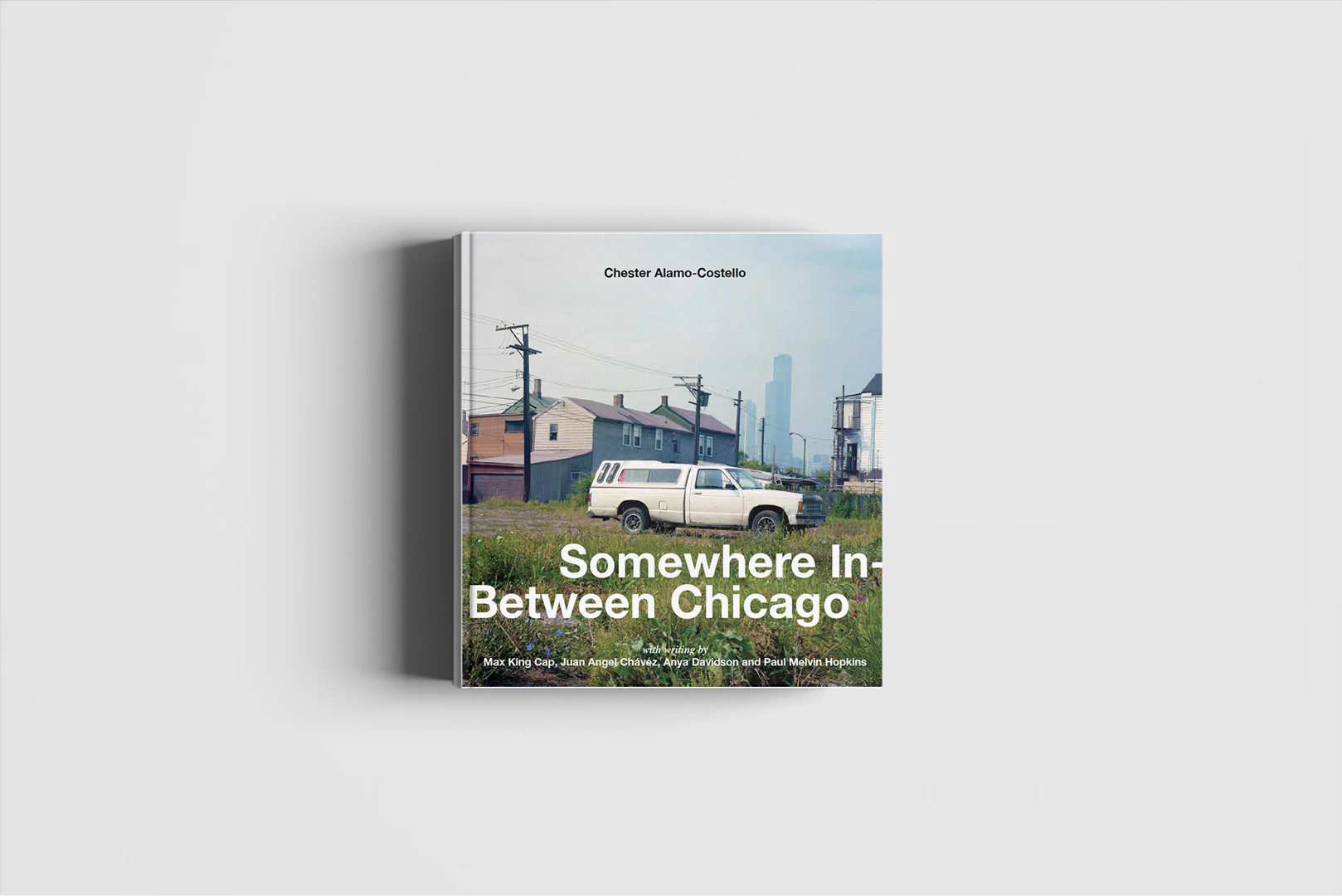 picture of the book Somewhere In-Between Chicago by Chester Alamo Costello